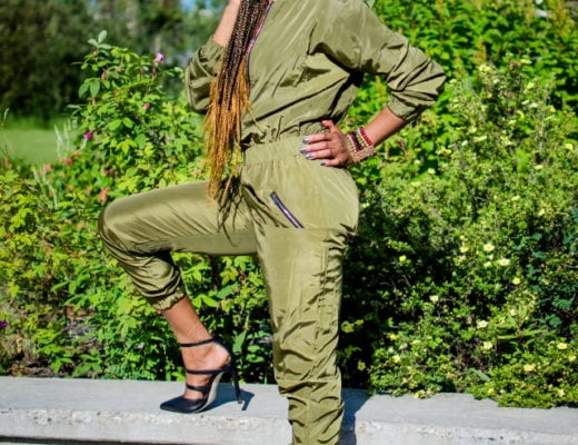 Olive Bomber Jumpsuit | Fashion blogger rocking a one-piece, long-sleeve jumpsuit paired with a multi strap sandals for a chic street style outfit. Click to check out more of her fun and affordable style.