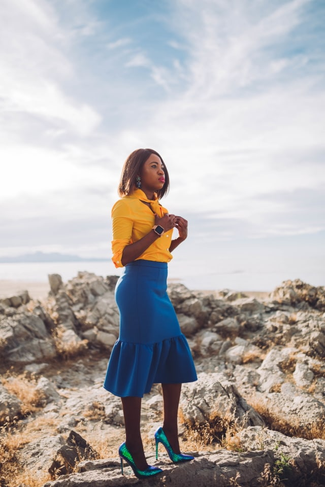 Never thought blue & yellow would look this good! Very work appropriate and stylish with the neck tie bow and peplum midi skirt. 💛💙 Work style, dressy outfit, women's style, black girl, Nigerian blogger, pussy bow top, neoprene skirt, iridescent hologram heels
