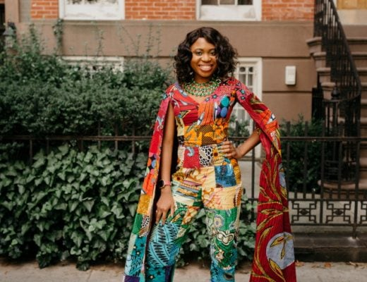 How I love the dramatic cape sleeves of this rainbow patchwork ankara jumpsuit. I'm sure she turned heads when she showed up to New York Fashion Week dressed like this. With simple wavy hair, black pumps and green statement necklace to match, it'll be no surprise if the media swoons over her. Stunning New York Fashion Week Fall/Winter 2017 outfit #NYFW #ootd #Ankara #Kente