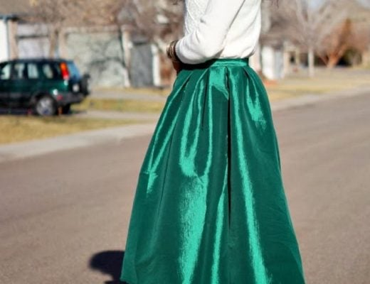 Holiday outfit idea wearing a green midi skirt