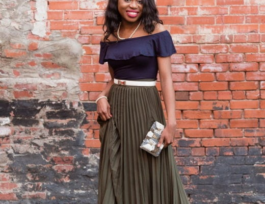 Wedding guest outfit inspiration wearing pleated maxi skirt.