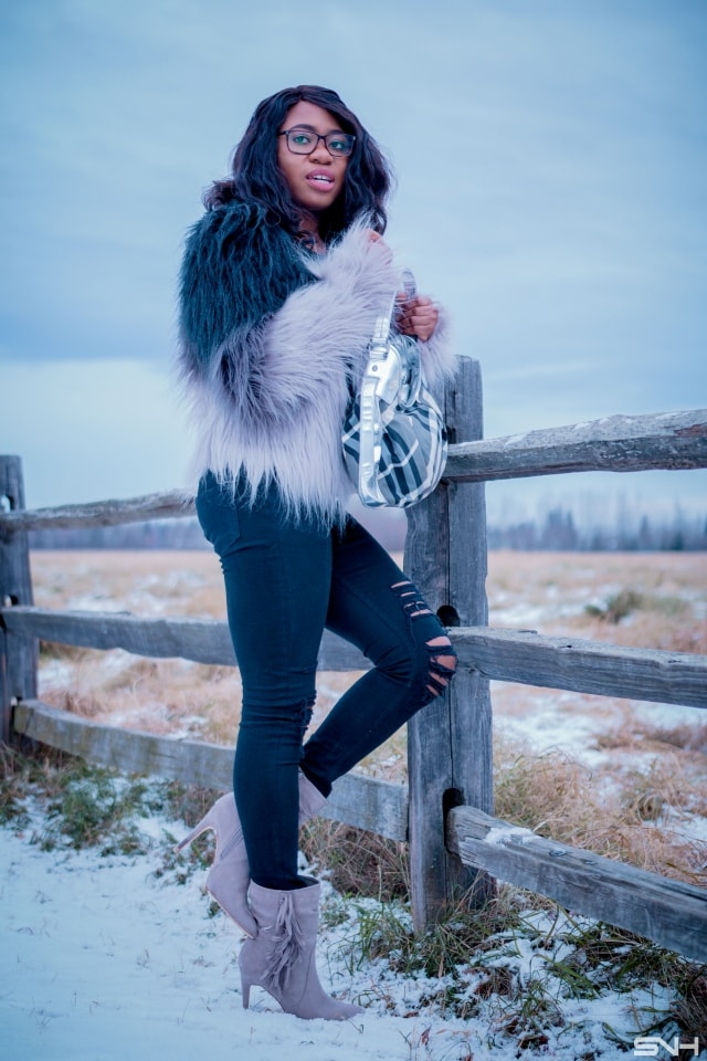 Faux fur jacket outfit | Q trendy fall street style combining ombre faux fur coat, ripped black jeans, fringe ankle booties. Fashion blogger | Alaska | Black blogger | Fall fashion | Ripped denim