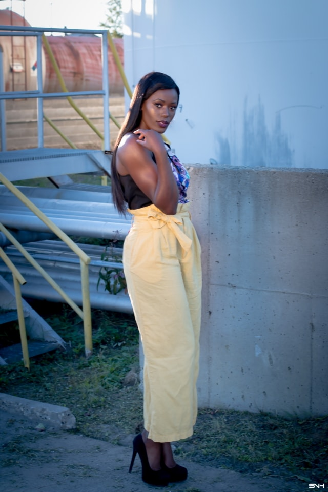 "All about making a bold color statement this season! 🌈 Love how this African beauty rocked this mustard yellow pants. Pairing the linen pants with darker colors of blue and black and light makeup, she let her outfit ""do the talking."" I would wear this outfit any day. Color Pop: How to rock bold colors this season. #ootd #melanin"