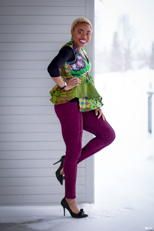It keeps getting better with African print styles. Totally crushing on this African print wrap top. Fashion blogger, Louisa Moje shares how she styles African print clothes in everyday life by pairing them with contemporary pieces. Faux suede denim, suede bow heels, and 3/4 sleeve top with statement earrings bring this ankara print top to life. #ankara #africanprint #ankarafashion #springfashion