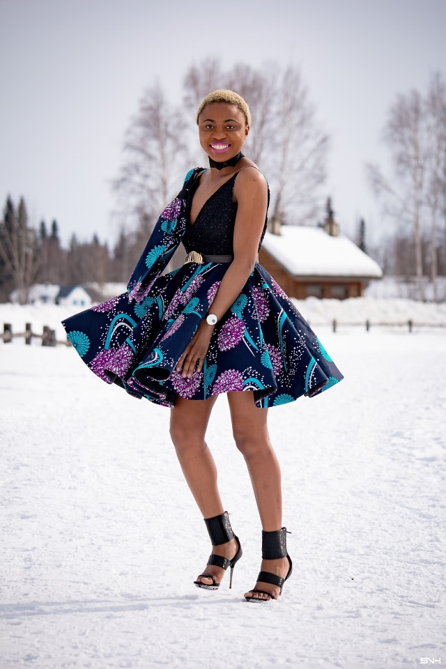 Millennial fashion and beauty blogger, Louisa takes us on an epic fashion series showcasing some of the most spectacular, wearable African print styles we've ever seen! Case in point, this elaborate African print cocktail dress made with premium ankara fabric mixed with a sequin V neck fabric and an exposed back. And oh, she makes winter in Alaska look so balmy! Dashiki, African print dress, African fashion, African women dresses, African prints, Nigerian style, Nigerian fashion