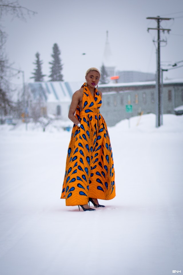 OMG where can I get this jaw-dropping ankara print dress? I need African print dresses like this multiway wax print dress that can be worn in multiple ways. And the way Louisa styled this dress as part of her 30 days of African outfits has me drooling. Such a unique contrast wearing a summer dress in the heart of winter! #africanprint #ankarafashion African prints, Nigerian fashion, African fashion, African print dresses, African dresses